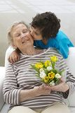Happy grandmother with her little son with flowers Stock Photo