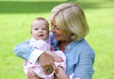 Happy grandmother holding cute baby Royalty Free Stock Photography