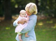 Happy grandmother holding cute baby Stock Images