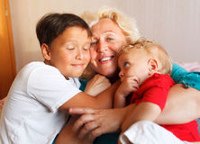 Happy grandmother hugging with her grandsons Stock Photography