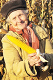 Happy grandmother with maize Royalty Free Stock Images
