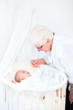 Happy grandmother talking to newborn grandson Royalty Free Stock Photos