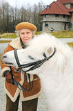 Happy grandmother with white pony Royalty Free Stock Photography