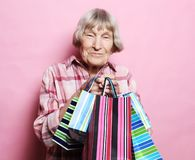Happy Grandmother With Shopping Bags Over Pink Background. Lifestyle And People Concept. Stock Images