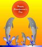 Happy Grandparent's Day. Older and younger dolphins jumping in the water playing Royalty Free Stock Photography