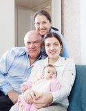 Happy grandparents with daughter and granddaughter Stock Images