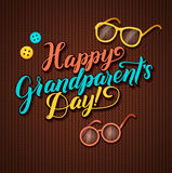 Happy Grandparents Day Calligraphy Greeting Card in Brown Knitted Background with Glasses and Buttons Stock Photo