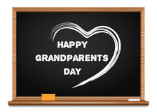 Happy Grandparents Day chalkboard. Congratulatory inscription written in chalk on a blackboard. Chalk text and heart on a wooden blackboard. National Stock Photo