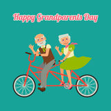 Happy grandparents day. Postcard Happy Grandparents Day. Grandmother and  grandfather riding on a tandem bicycle. Enjoying life. Anniversary Stock Photo