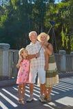 Happy grandparents and grandchild, selfie. Royalty Free Stock Image