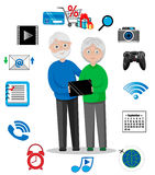 Happy Grandparents with Tablet Royalty Free Stock Image