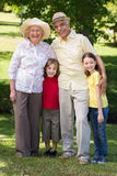 Happy grandparents with their grandchildren at the garden Stock Images