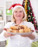 Happy granny  with cookies in Christmas night,Xmas concept Stock Photography