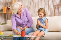 Happy granny and grandchild drawing together Royalty Free Stock Photos