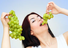 Happy grapes eating royalty free stock photography