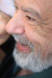 Happy gray. Vital senior man with gray beard smiling Royalty Free Stock Photo