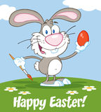 Happy Gray Rabbit Painting Easter Egg Stock Photos
