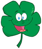 Happy green clover cartoon character Stock Photos
