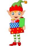 Happy green elf boy costume holding birthday gifts Stock Image
