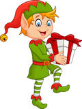 Happy green elf boy holding gifts Stock Photo