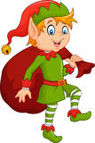 Happy green elf boy holding gifts Royalty Free Stock Images