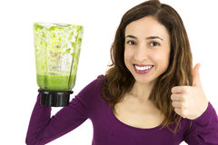 Happy green smoothie woman thumbs up Stock Photo