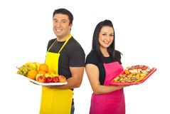 Happy greengrocer and confectioner Royalty Free Stock Image