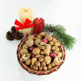 Happy Greeting Seasons - get your Good Luck. Symbols of Christmas and New Year on White background. Christmas decoration. The good meat of the walnut broken in Royalty Free Stock Photos