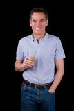 Happy Grinning Man Toasting with a Drink Royalty Free Stock Image