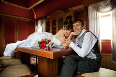 Happy groom. Beautiful pair of just married men and wife Royalty Free Stock Photography