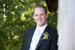 Happy groom. Handsome young groom smiles on his wedding day Royalty Free Stock Photo