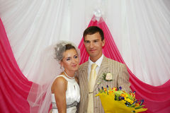 Happy groom and beautiful bride smile indoor Stock Image