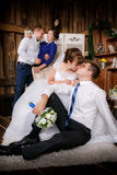 Happy groom, bride, groomsman, bridesmaid are in the room Royalty Free Stock Photos