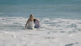 Happy groom and bride have in the ocean stock video footage