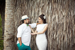 Happy groom and bride having fun in a tropical jungle under the Stock Photos