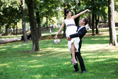 Happy groom with bride in his arms Royalty Free Stock Photography