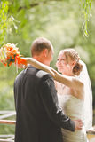 Happy groom and bride look at each other Stock Photos