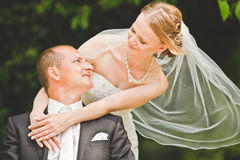 Happy groom and bride look at each other Stock Photography