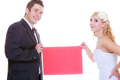 Happy groom and bride posing for marriage photo Royalty Free Stock Images