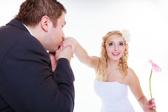 Happy groom and bride posing for marriage photo Stock Images