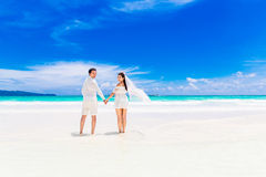 Happy groom and bride on the sandy tropical beach. Wedding and h Royalty Free Stock Photo