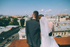 Happy groom and bride are standing on the roof Royalty Free Stock Images