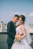 Happy groom and bride are standing on the roof Stock Images