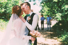 Happy groom and bride under tree Stock Photography