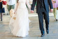 Bride and groom walk. Happy groom and bride walk on road Royalty Free Stock Images