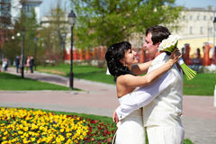 Happy groom and bride on wedding walk Stock Photo