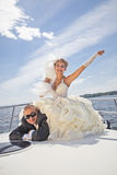 Happy groom and the bride on the yacht Stock Photography