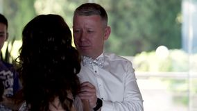 Happy groom dance and look to the he`s lovely Bride while dancing stock video footage