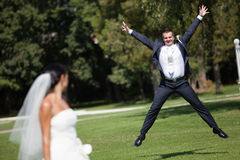 Happy groom in jump Royalty Free Stock Image