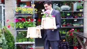 Happy groom putting flowers in the car stock footage